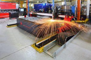 CNC laser machine in PDI's Erie, PA manufacturing facility