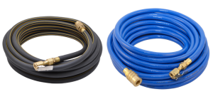 A black roll and a blue roll of pneumatic hoses with brass fittings