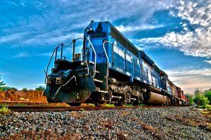 Blue locomotive on rail tracks