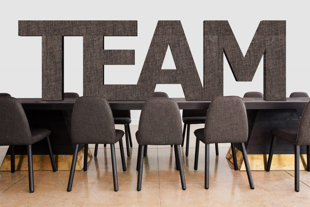 The word team on an office table with chairs