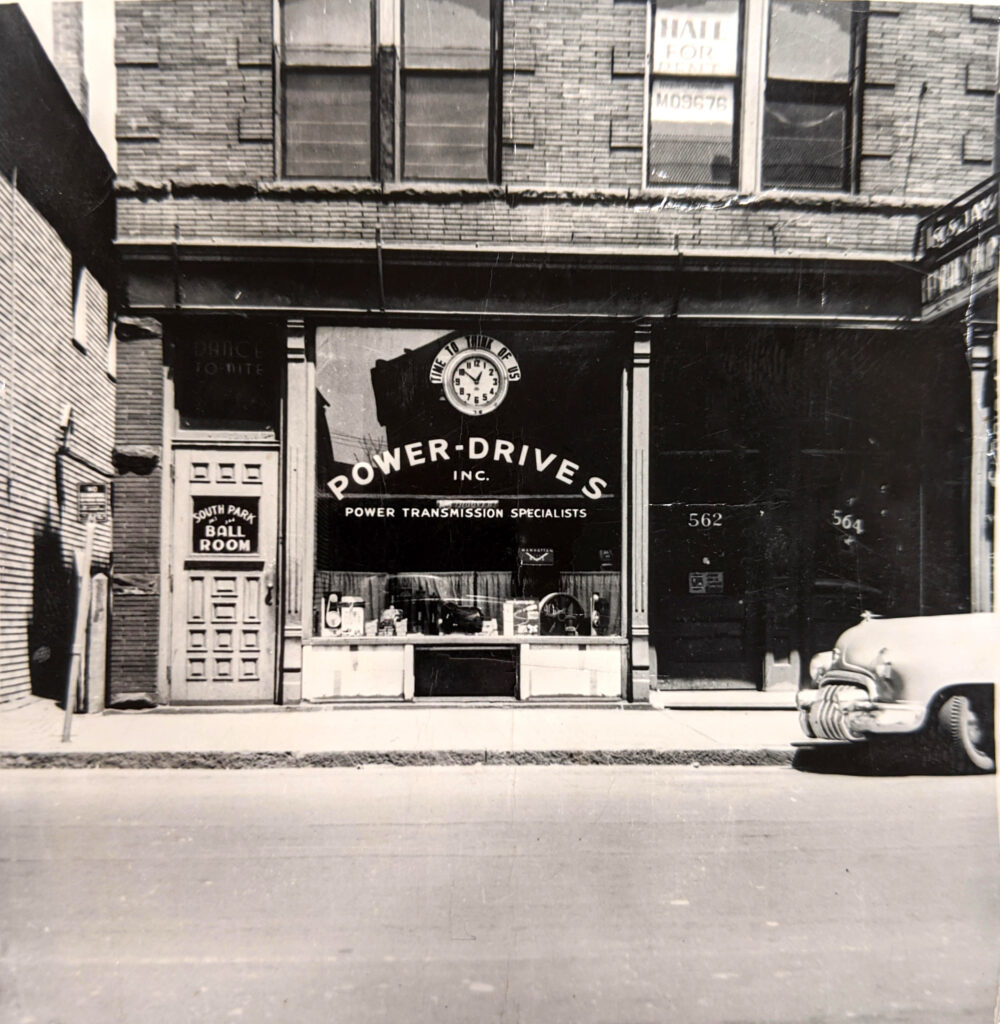 Black and White Photo of power Drives, Inc. Storefront